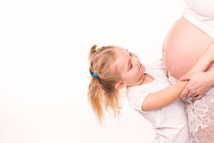 Happy child holding belly of pregnant woman Royalty Free Stock Images