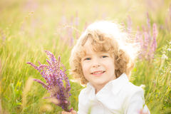 Happy child holding bouquet Stock Photos