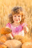 Happy child holding bread Stock Photography