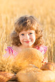 Happy child holding bread Royalty Free Stock Photo