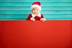 Happy child holding cardboard banner blank stock image