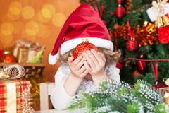 Happy child holding Christmas ball Stock Images