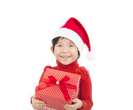 Happy child holding christmas gift Stock Photos