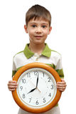 Happy child holding clock Stock Photography