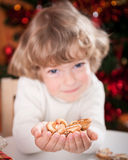 Happy child holding cookies Stock Image