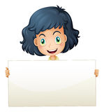 A happy child holding an empty signboard Royalty Free Stock Photo