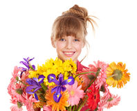 Happy child holding flowers. Royalty Free Stock Image