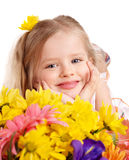 Happy child holding flowers. Royalty Free Stock Photos