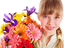 Happy child holding flowers. Royalty Free Stock Images