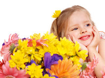 Happy child holding flowers. Royalty Free Stock Photo