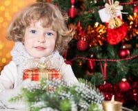 Happy child holding gift Stock Image