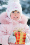 Happy child holding gift box Royalty Free Stock Photos