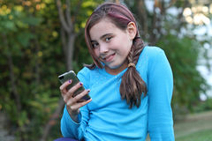 Happy child holding hand held electronic device. Royalty Free Stock Images