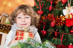 Happy child holding present Royalty Free Stock Photo