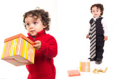 Happy child holding a present set with tie Stock Images