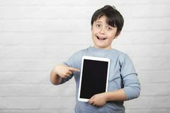 Happy child holding a tablet stock image