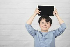 Happy child holding a tablet royalty free stock image