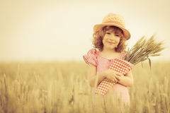Happy child holding wheat Royalty Free Stock Images