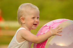 Happy child holds ball Royalty Free Stock Images