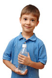 Happy child holds bottle of water Royalty Free Stock Image
