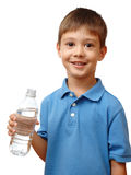 Happy child holds bottle of water Stock Image