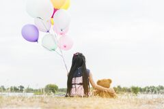 Happy Child hug teddy bear hold air balloon in green park playground. Teddy bear best friend for little kids cute girl. Autism