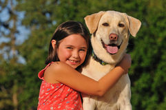Happy child hugging a dog royalty free stock image