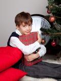 Happy child hugs Christmas gift Royalty Free Stock Image