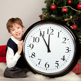 Happy child hugs Christmas gift Stock Photography