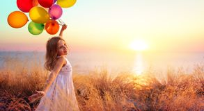 Free Happy Child In Freedom With Balloons Stock Image - 156156541