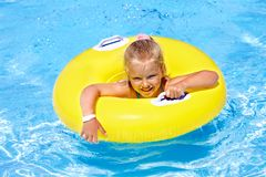 Child on inflatable ring in swimming pool. stock images