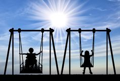 Free Happy Child Is Handicapped In A Wheelchair On An Adaptive Swing Having Fun With A Healthy Child Together Royalty Free Stock Photos - 144899628