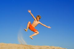 Happy child jumping Royalty Free Stock Photography