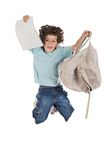 Happy child jumping with backpack Royalty Free Stock Photo