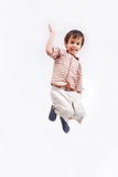 Happy child is jumping high isolated Royalty Free Stock Images