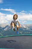 Happy child jumping Stock Images