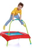 Happy child jumping on a trampoline Royalty Free Stock Photography