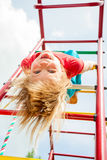 Happy child on a jungle gym Stock Images
