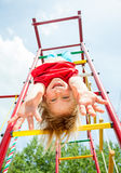 Happy child on a jungle gym Royalty Free Stock Photography