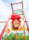 Happy child on a jungle gym Royalty Free Stock Image