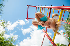 Happy child on a jungle gym Royalty Free Stock Photo
