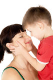 Happy child kiss his mother. Isolated on white background Stock Image