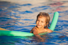 Happy child learning to swim Royalty Free Stock Photos