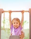 Happy Child Lifting On Crossbar Stock Image
