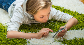 Happy child listening to music. Stock Photo