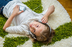 Happy child listening to music. Stock Image