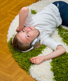 Happy child listening to music. Royalty Free Stock Image