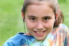 Happy child listening to music with headphones on. Royalty Free Stock Photos