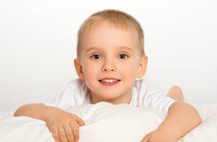 Happy child little boy  in bed Stock Photography