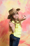Happy child or little smiling girl in cowboy hat Royalty Free Stock Photography